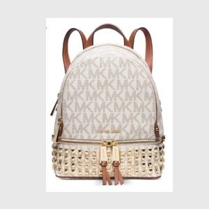 Michael Kors Backpack neutral with studs.  Used